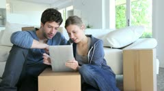 Young couple using tablet to find transport company Stock Footage