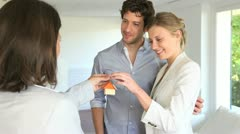 happy young couple getting keys of their new home - stock footage