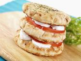 Pita bread sandwich with goat's cheese and tomatoes Stock Photos