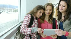 teenagers using electronic tablet in school hall - stock footage