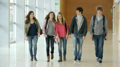 Group of students running out of class Stock Footage
