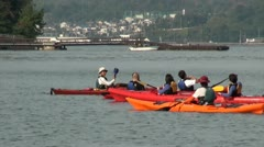 Tourists use canoes to visit the floating torii gate in Japan (zoom out) Stock Footage