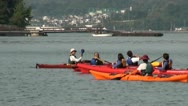 Stock Video Footage of Tourists use canoes to visit the floating torii gate in Japan (zoom out)