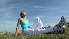 woman in fitness outfit relaxing outside in countryside - stock footage