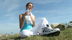 Woman in fitness outfit drinking water from bottle Stock Footage