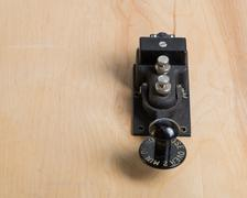 antique telegraph key on a desk - stock photo