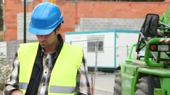 foreman on building site with walkie-talkie - stock footage