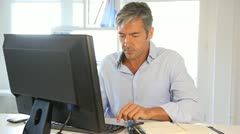 office worker in front of desktop computer - stock footage