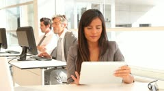 Businesswoman working in office with tablet Stock Footage