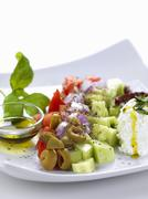 Greek salad with olive oil Stock Photos