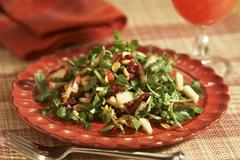 Watercress Salad with Apples, Cranberries and Peanuts; On a Plate; Fork - stock photo
