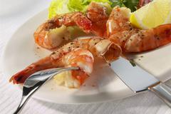 Stock Photo of Peeling sauteed shrimp