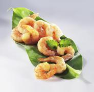 Peeled shrimp on a leaf - stock photo