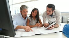 team of architects working in office - stock footage