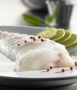 Monkfish fillet with rose pepper and limes Stock Photos