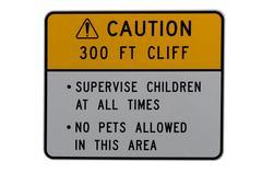 Caution hazardous cliff  alert sign Stock Photos