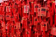 Stock Photo of Red Buddhist prayer tablets.