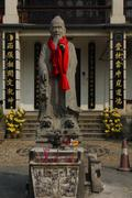 Statue of confucius in chinese temple. Stock Photos