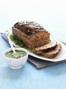 Meatloaf with herb sauce - stock photo