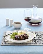 Lamb shoulder with chocolate sauce, mashed potatoes and lima beans Stock Photos