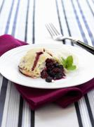 Sweet pastry with berry filling Stock Photos