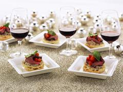 Canapes with roast beef and red wine Stock Photos