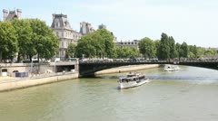 Bateau mouche cruising on the seine river Stock Footage