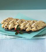 Sliced Stollen on a blue and white polka dotted serviette - stock photo