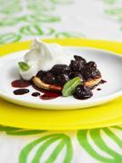 Mini cherry tart with whipped cream - stock photo