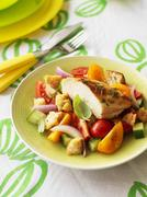 Grilled chicken breast on Tuscan bread salad - stock photo