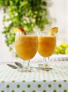 Two glasses of Peach Bliss - stock photo