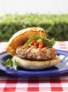 Mediterranean burger with tomato caper relish - stock photo