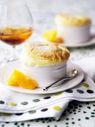 Orange souffle garnished with fresh oranges - stock photo