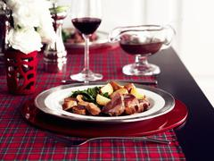 Veal with potatoes and gravy - stock photo
