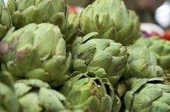 Artichokes on a market stall - stock photo