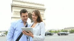 Couple using tablet by the arch of triumph Stock Footage