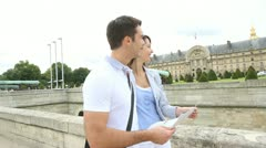 Couple reading tourist map in front of the invalides building Stock Footage