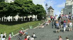 paris - circa july 2012: people congregate on the steps in front of the facad - stock footage