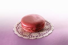 Rose macaroon on a doily - stock photo