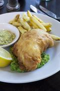 Fish and chips with mushy peas and tartar sauce Stock Photos