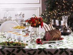 Stock Photo of Christmas table with roast prime rib and side dishes