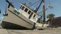 Hurricane pushes shrimp boat on shore Stock Footage