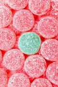 Pink jelly tots with a green jelly tot Stock Photos