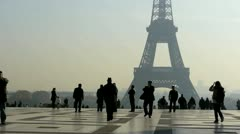 tourist in front of the the eiffel tower - view from the trocadero museum - p - stock footage