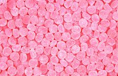 Rose colored chewy candies Stock Photos