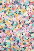 Lots of brightly colored chewy candies - stock photo