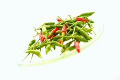 Green and red chilli peppers from Thailand Stock Photos