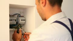 electrician installing electric meter - stock footage