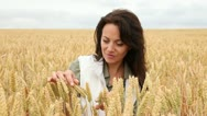 Stock Video Footage of woman looking at wheat crops