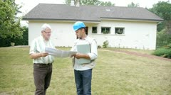 architect meeting private individual at home - stock footage
